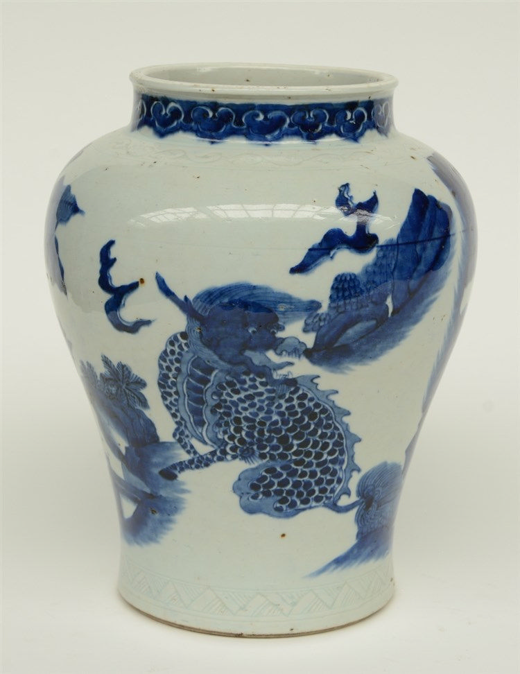 A Chinese blue and white vase, overall decorated with mythical animals in a