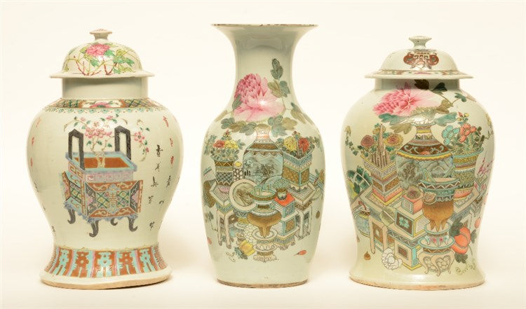 Two Chinese famille rose vases and covers, decorated with vas of flowers an