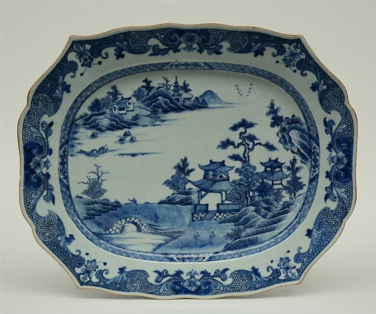 A fine Chinese blue and white plate, decorated with figures in a riverlansc