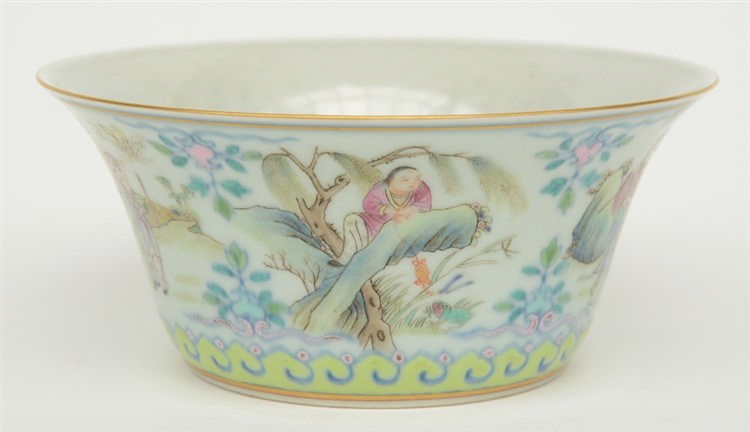 A Chinese famille rose bowl, decorated with several garden scenes, marked X