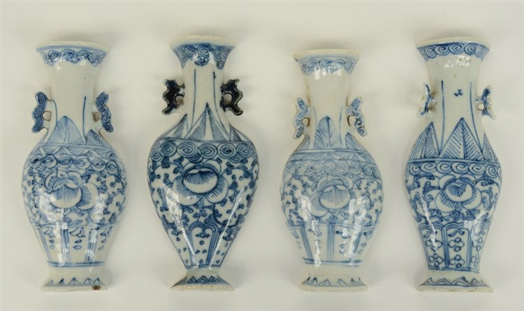 Four Chinese blue and white wall pockets, modeled as vases, decorated with