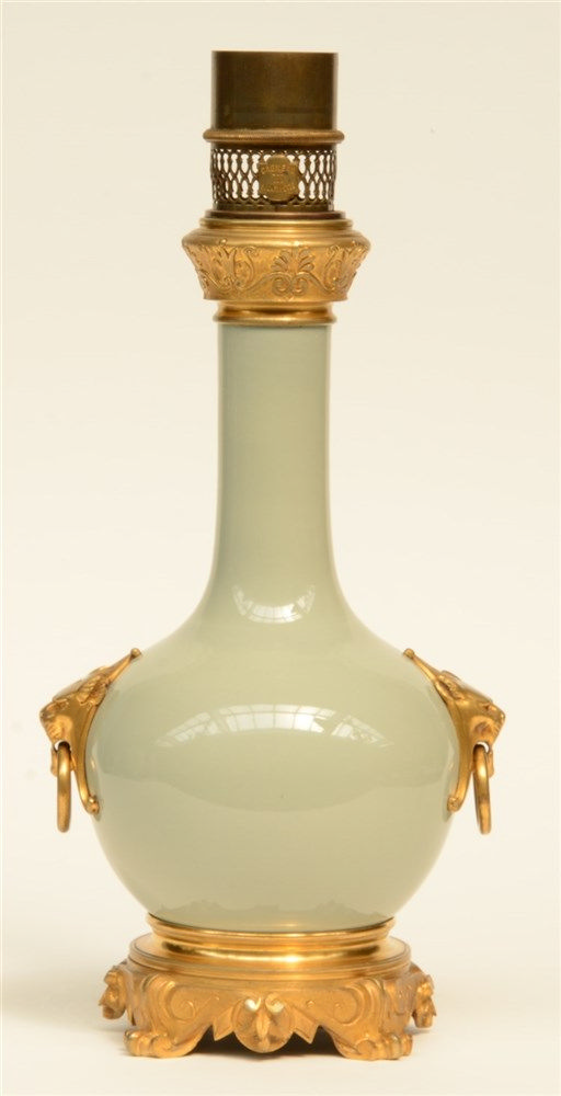 A Chinese celadon bottle vase, with gilt bronze and brass mounts, mounted i
