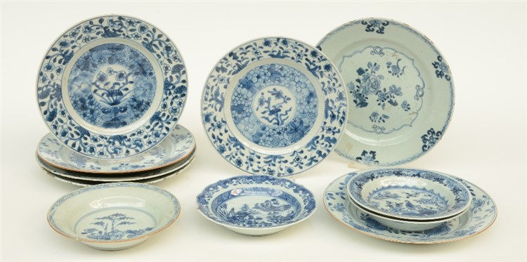 Seven Chinese blue and white dishes decorated with floral motifs, 18thC; ad