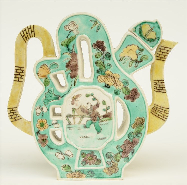 A Chinese polychrome teapot and cover decorated with figures in a garden an