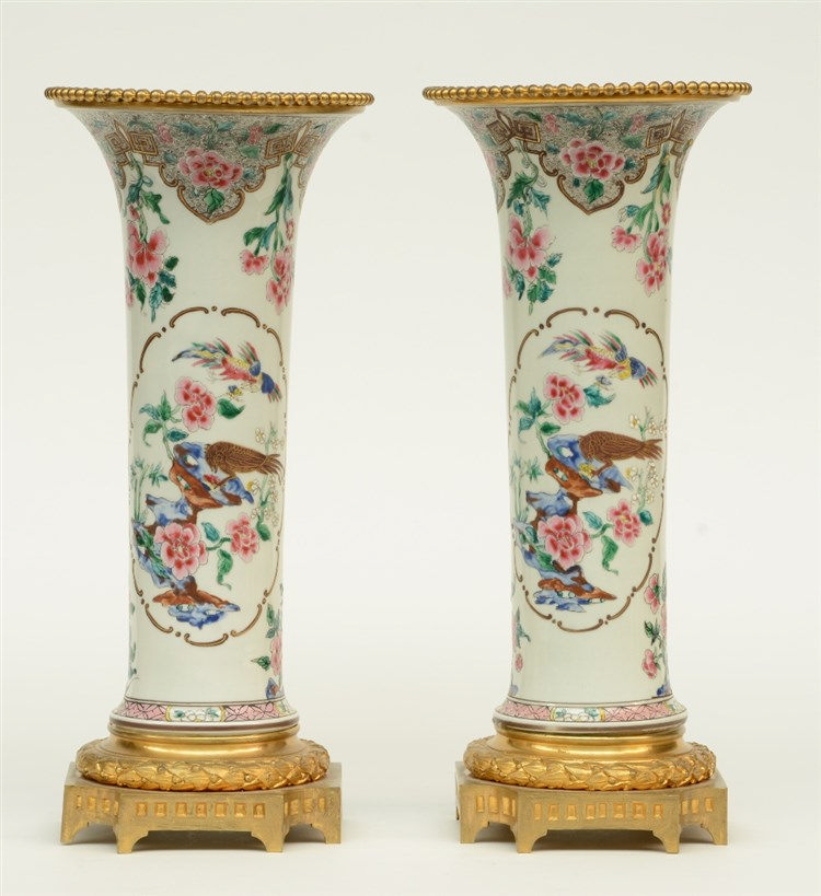 A pair of Chinese famille rose vases, decorated with birds and flower branc