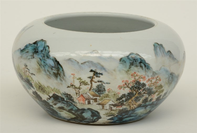 A Chinese polychrome bowl, decorated with figures in a river-mountain lands