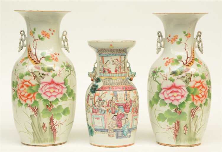 A pair of Chinese polychrome vases, decorated with a bird on flower branche