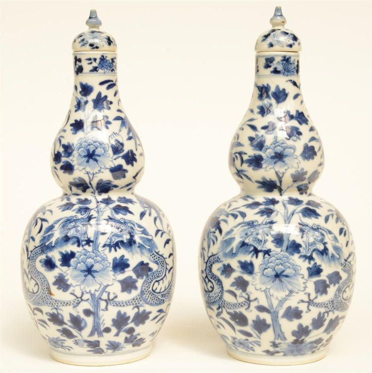 A pair of Chinese blue and white double gourd vases and covers, decorated w