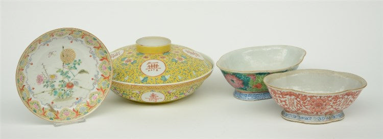 A Chinese polychrome bowl and cover, and two bowls, decorated with floral m