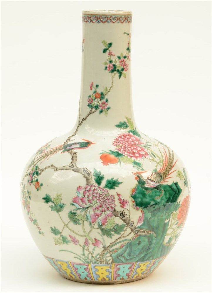 A Chinese famille rose bottle vase, decorated with flowers, a rock, butterf