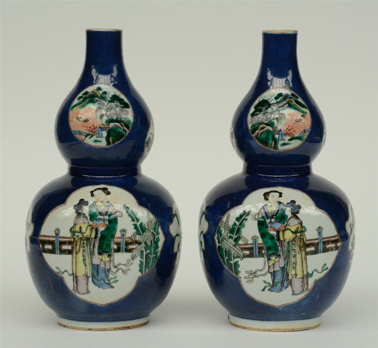 A pair of Chinese blue poudré double-gourd vases, the roundels famille vert