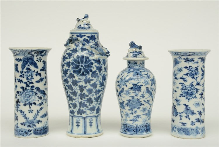 Two Chinese blue and white cylinder shaped vases and two vases and covers,