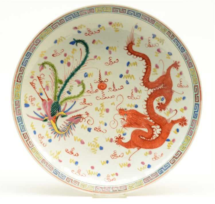 A Chinese polychrome plate, decorated with a dragon, a phoenix and the pear