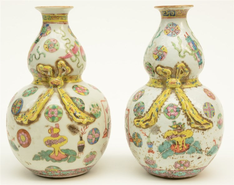 A pair of small Chinese famille rose kalebas vases, decorated with relief a