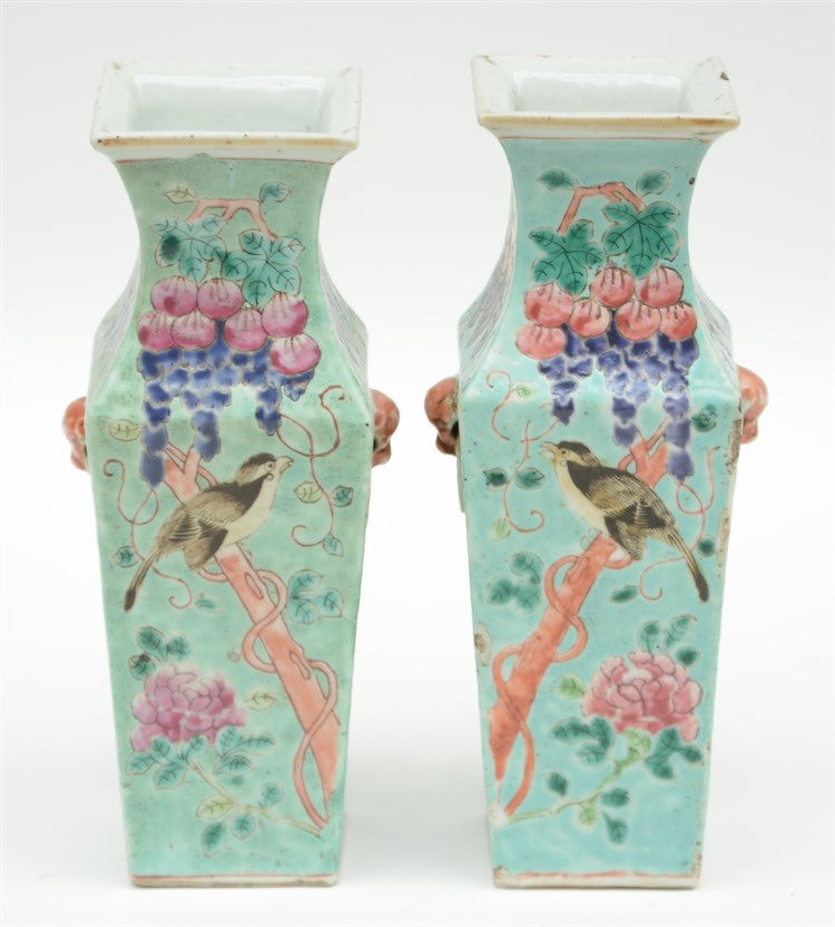 A small pair of Chinese quadrangular polychrome vases, decorated with grape