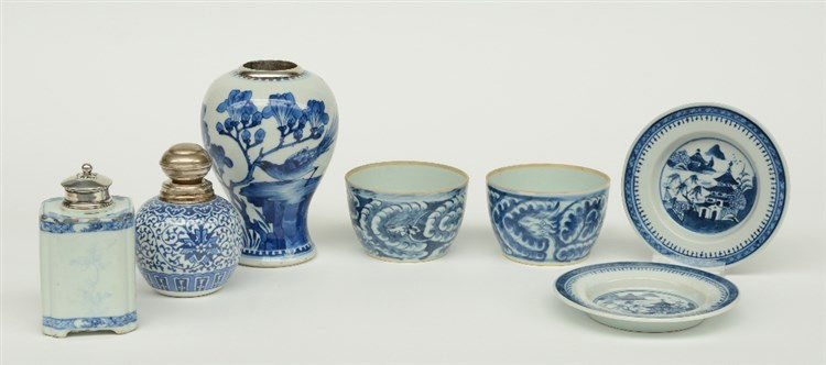 Two Chinese blue and white vases and a tea caddy, floral decorated, with si