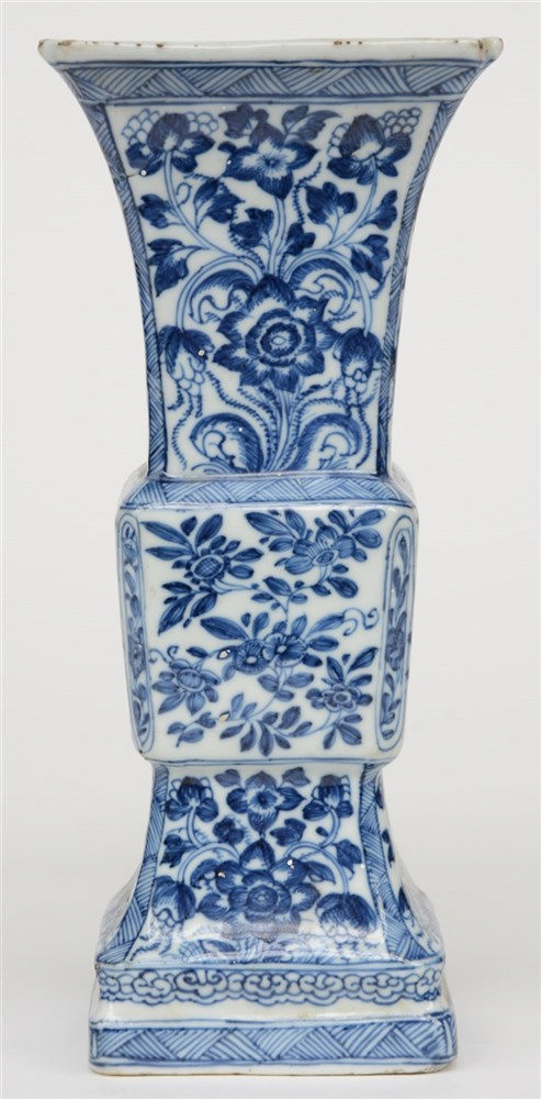 A Chinese blue and white quadrangular Gu-shaped vase, floral decorated, 18t