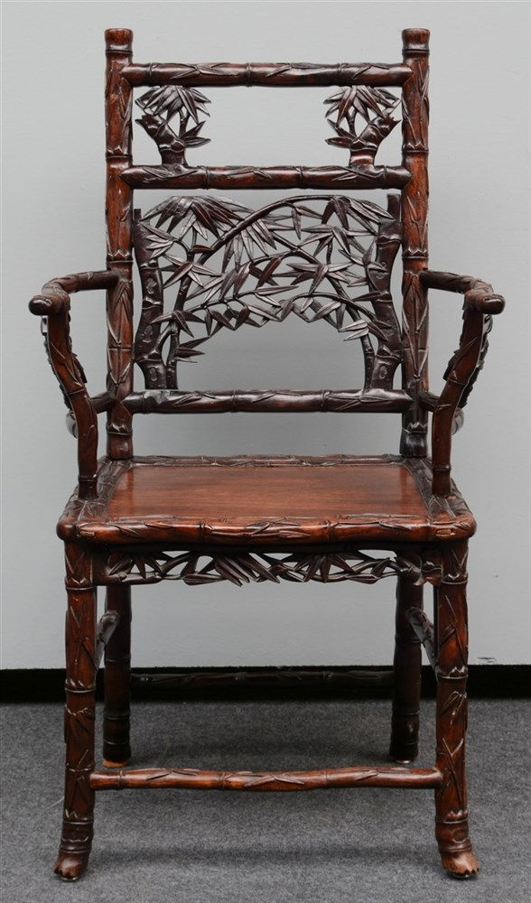 A Chinese hardwood armchair, carved bamboo imitation, H 104 - W 59,5 cm (mi