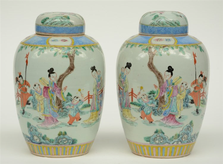 Two Chinese famille rose vases and covers, overall decorated with an animat