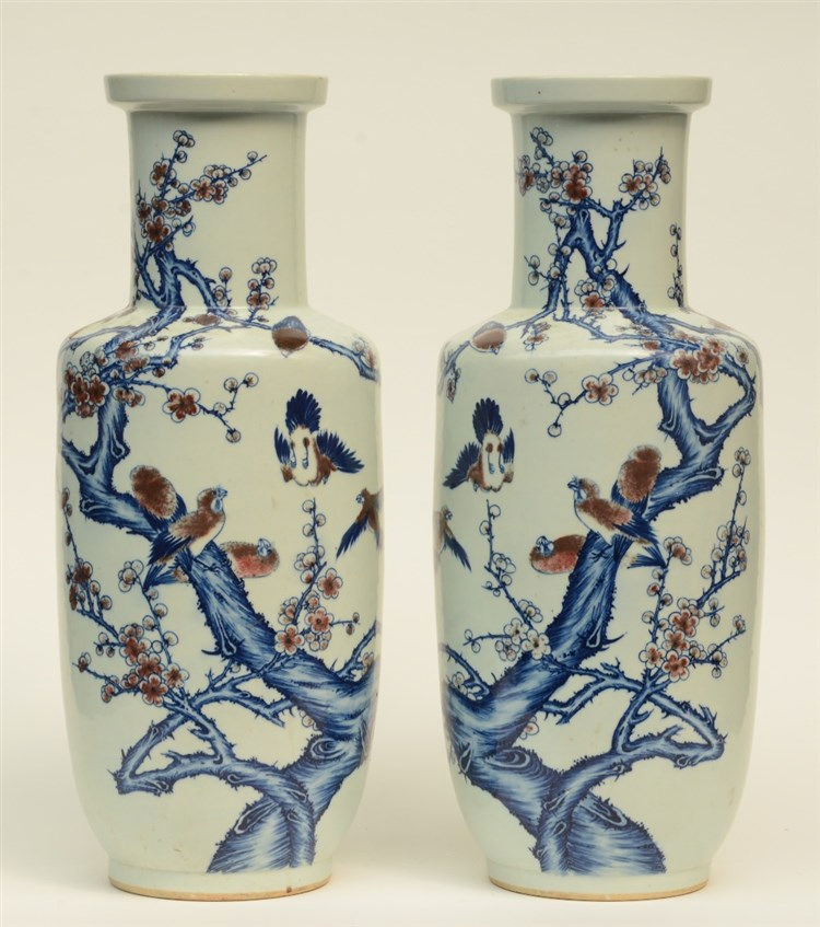 A pair of Chinese blue and white and cupper red glazed rouleau shaped vases