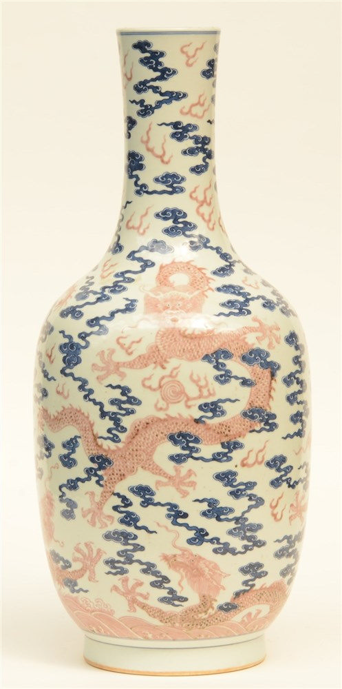 A Chinese blue and white and cupper red glazed bottle vase, decorated with