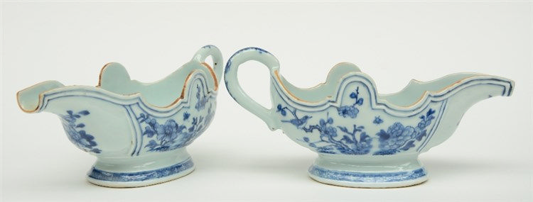 A pair of mid-18thC blue and white decorated Chinese porcelain sauce boats,