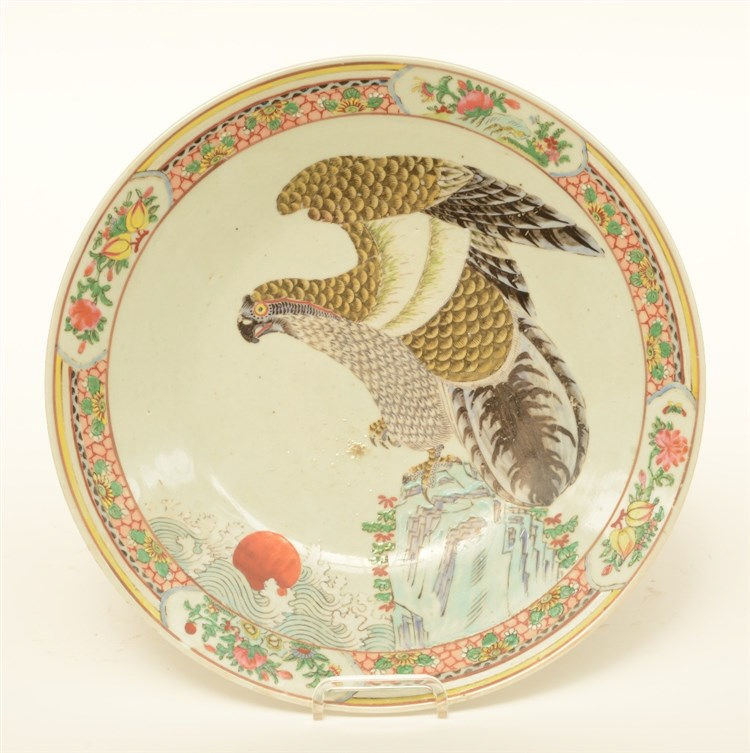 A Japanese polychrome plate, decorated with a falcon on a rock, 19thC, Diam