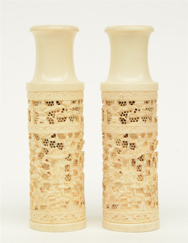 Two Chinese ivory open-work carved vases, overall decorated with figures in