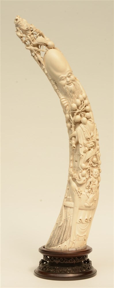 A first half 20thC Chinese Canton ivory sculpture depicting Shou-Xing, some