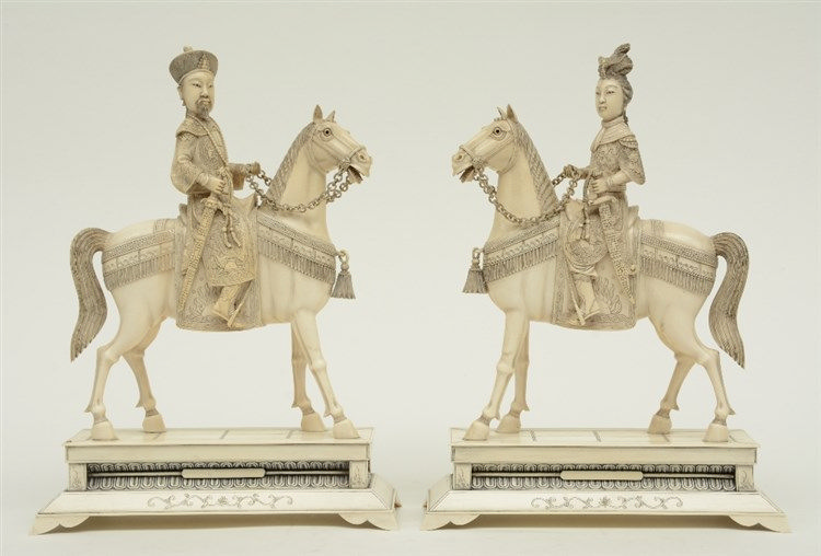 A pair of Chinese ivory figures of an imperial couple on horses, scrimshaw
