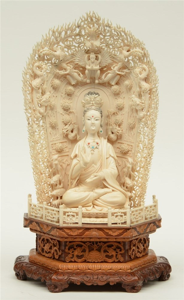 A Chinese ivory Guanyin, scrimshaw decorated, inlaid with various semi-prec