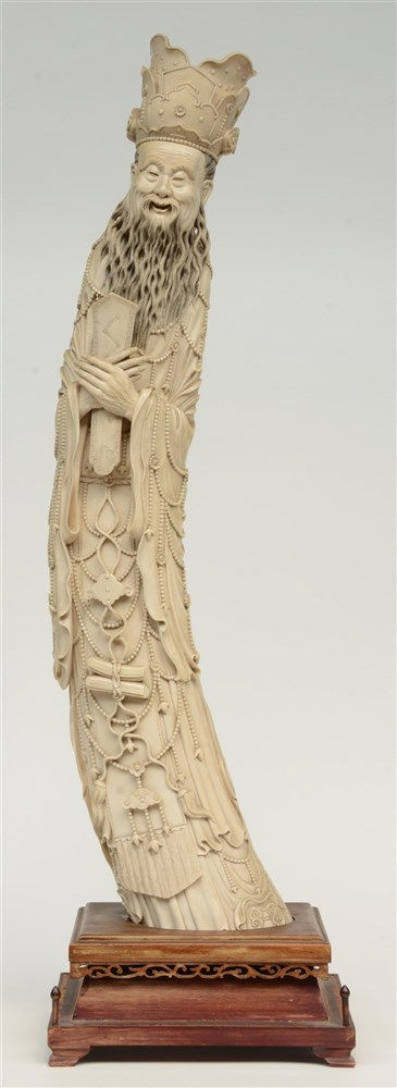 Chinese ivory sculpture depicting a sage, scrimshaw decorated, on a wooden