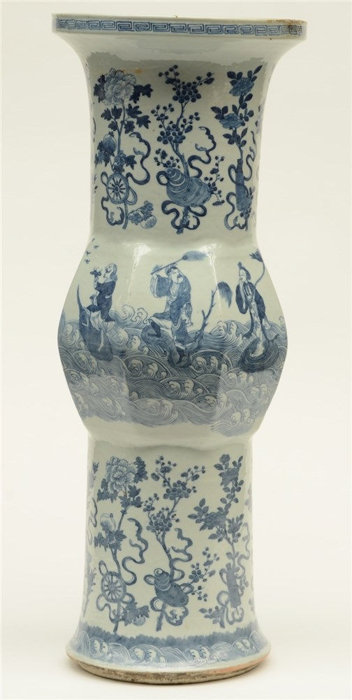 A Chinese blue and white Gu-shaped vase, decorated with the Eight Immortals