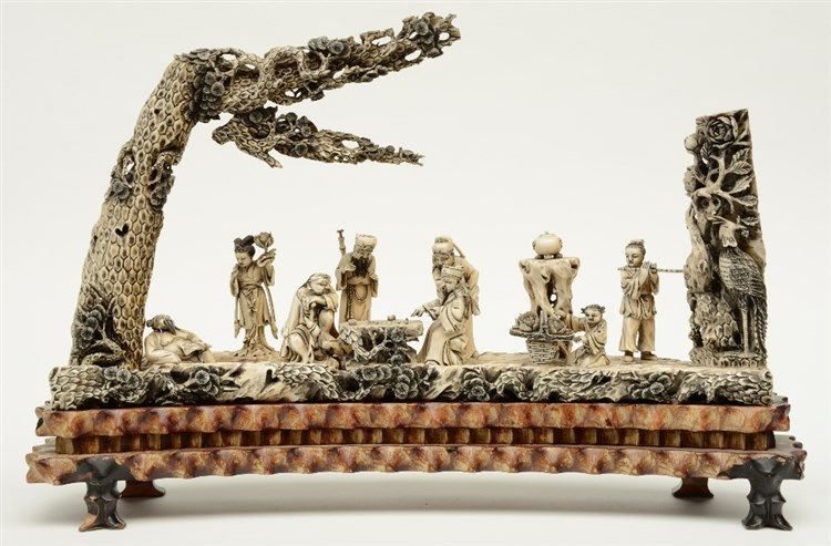 A fine Chinese ivory sculpture, depicting the Eight Immortals, scrimshaw de
