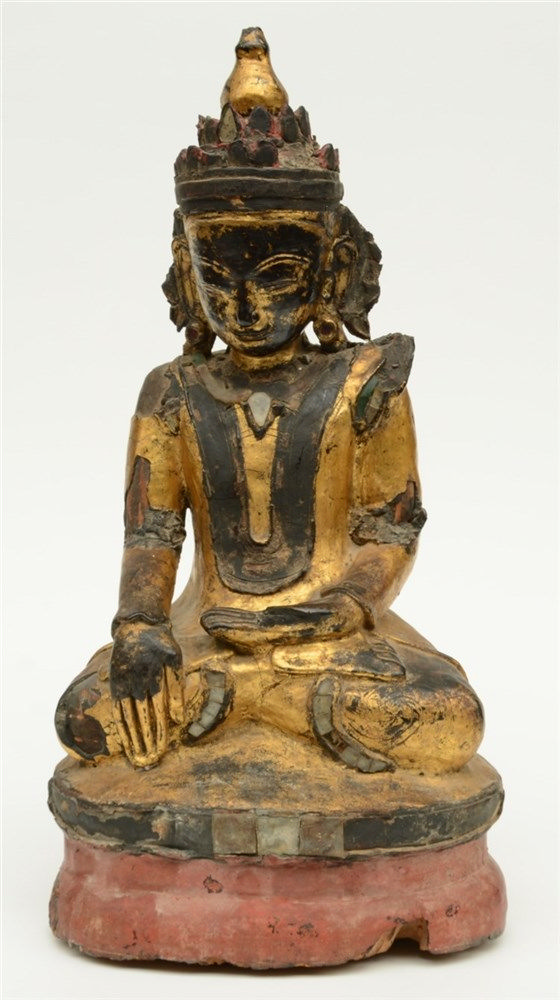 An Oriental polychrome and gilt lacquered wooden seated Buddha, decorated w