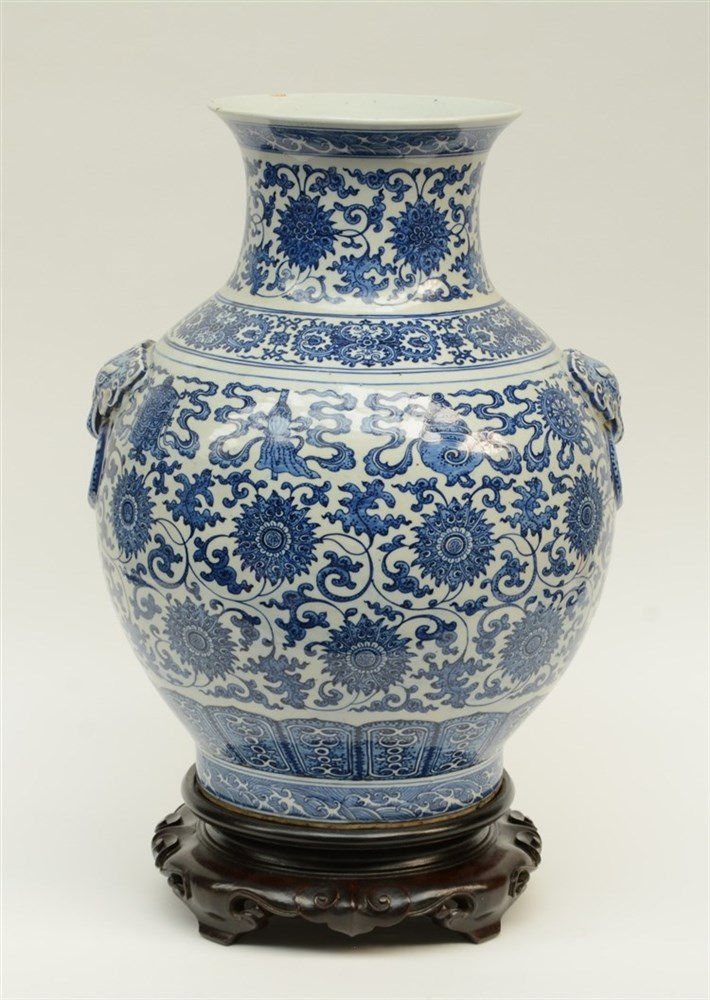 A large Ming-style blue and white vase, the high rounded shoulders set with