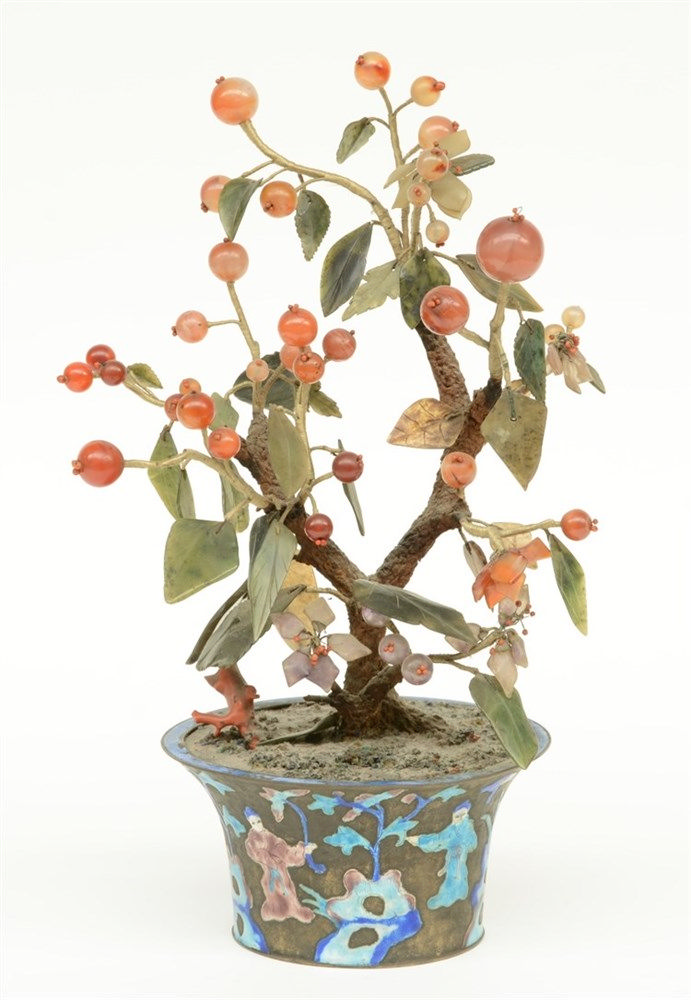 A Chinese ornamental tree with semi-precious stones in a brass enamel decor