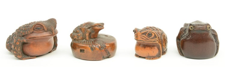 Three Japanese wooden katabori netsuke, the three of them depicting a toad,