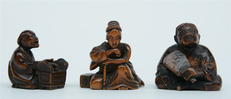 Three Japanese wooden katabori netsuke depicting rustic figures, Edo - and