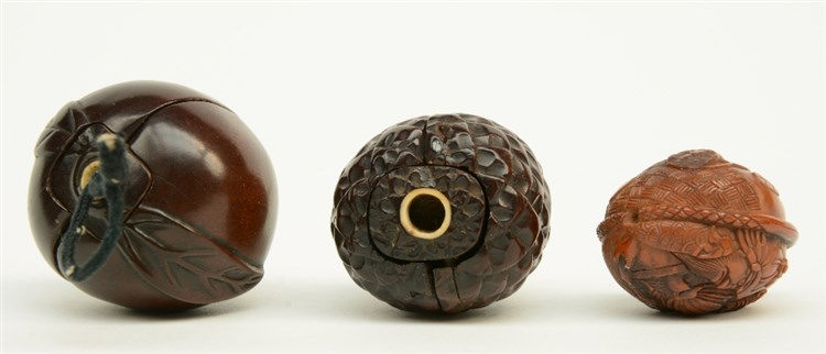 Two Japanese wooden karakuri netsuke, one in the form of a peach with insid