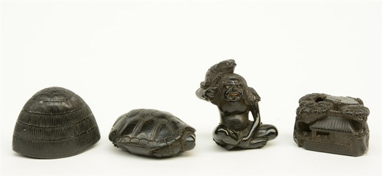 Four Japanese ebony netsuke depicting: one a man with a toad, signed; one a