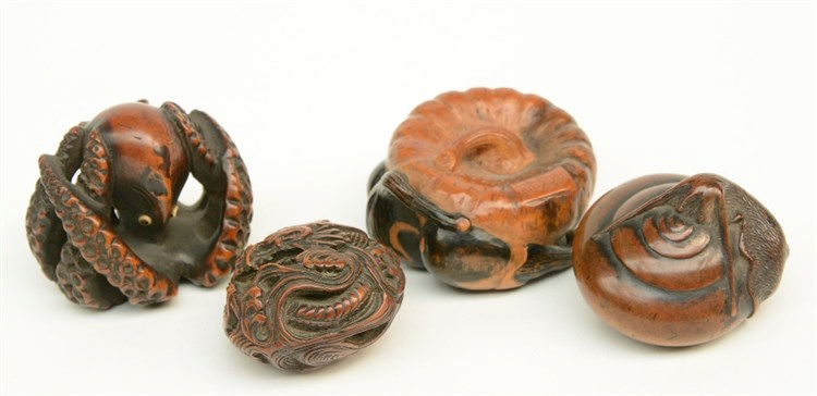 Two Japanese wooden katabori netsuke, one in the form of a pumpkin and thre