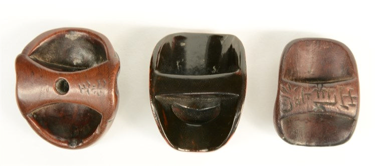 Three Japanese wooden mask netsuke, both signed; one in lacquer; all three
