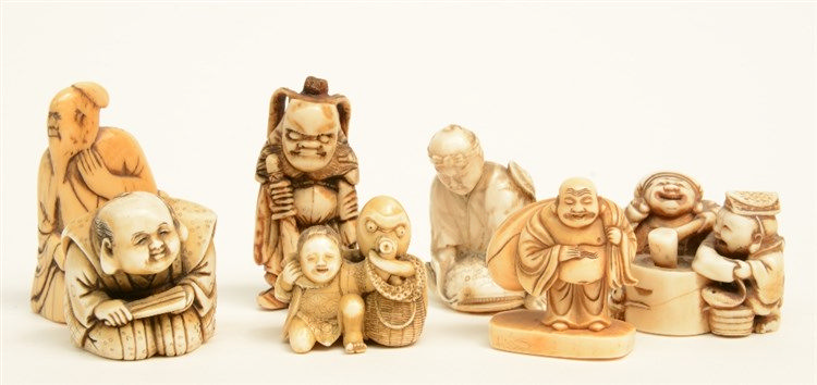 A lot of seven katabori netsuke out of bone, mammoth ivory and whale bone,