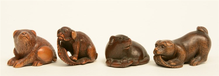 Three Japanese hardwood and horn okimono depicting a rat and two dogs; adde
