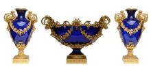 A rare cobalt blue crystal garniture with a fine Neoclassical ormolu mount,