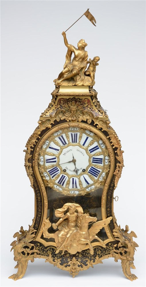 A rare cartel clock, tortoise shell veneered and with gilt bronze mounts, t