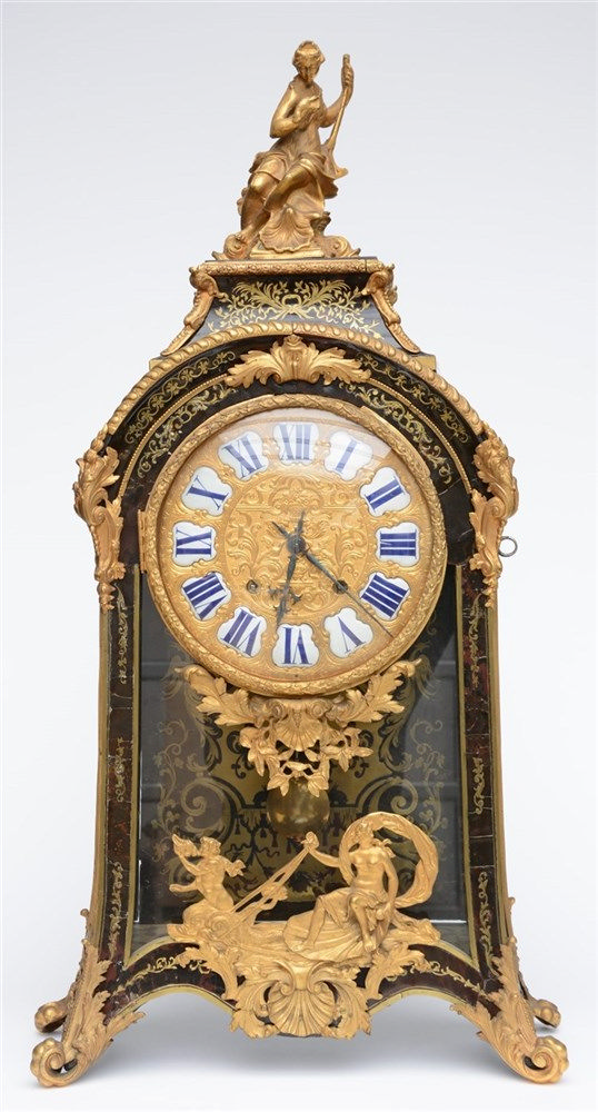 A rare LXIV style cartel clock, tortoise shell veneered and with gilt bronz