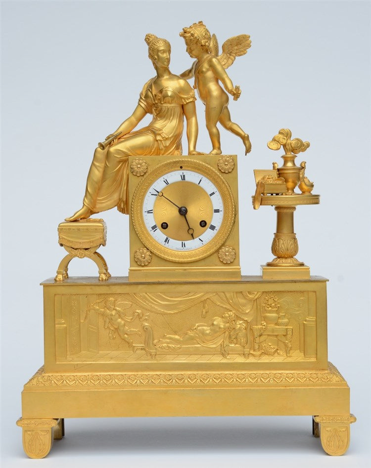 A rare ormolu mantel clock, decorated on top with Cupid and Psyche, the dia