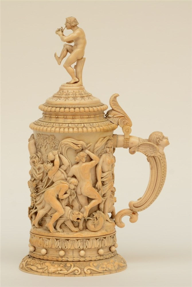 A rare German ivory Humpen, alto relievo sculpted with Bacchus on a chariot